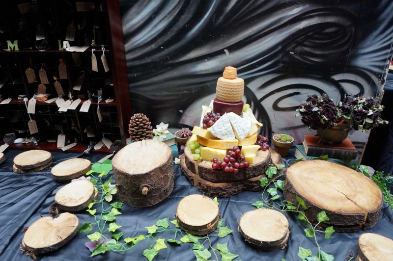13 goth-wedding-curious-table-curiosities-wish-tree-cheese-table-laura-devine-bride-planner-tasker