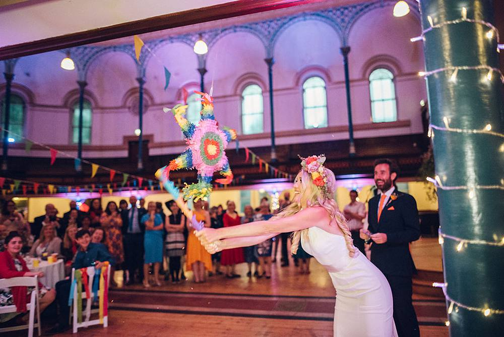 Devine Bride, Wedding Planner, Bohemian Wedding, Hippy Wedding, Round Chapel, Colourful Wedding, Bright Wedding Decor, London Wedding, Bright Flower Crown, Modern Wedding, Mariachi Band, Multi Coloured Bunting, Chloe Lee Photography, Pom Poms, Ribbons, Town Hall Wedding