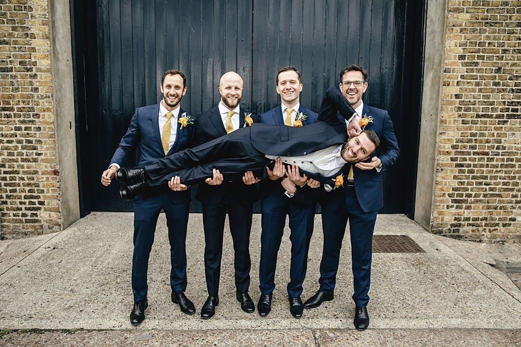 A contemporary and cool wedding at Trinity Buoy Wharf groom and his groomsmen
