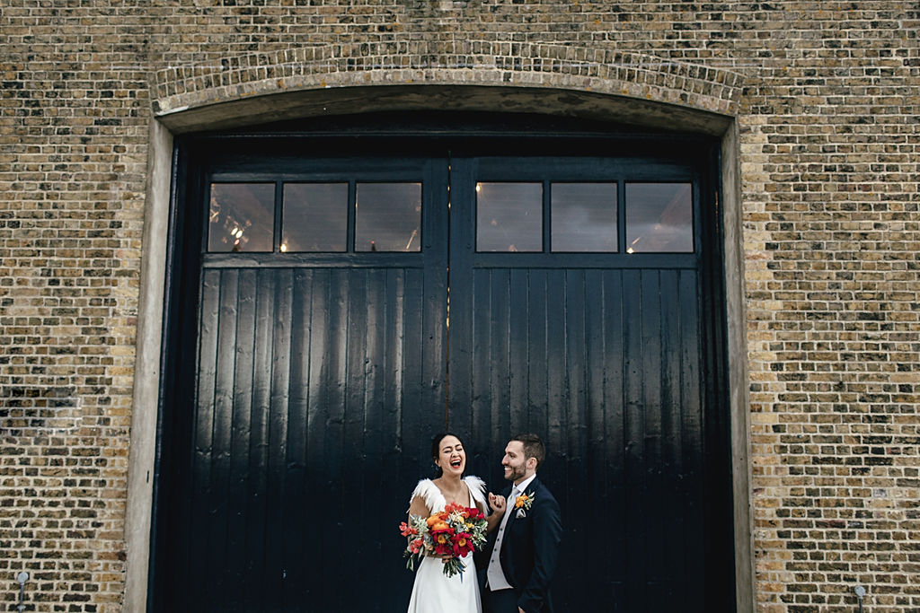 A contemporary and cool wedding at Trinity Buoy Wharf couple portraits
