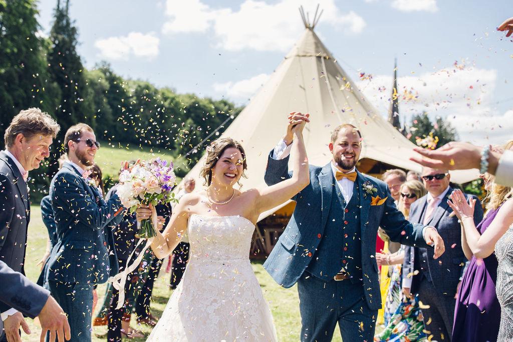 oudoor ceremony tipi wedding confetti exit