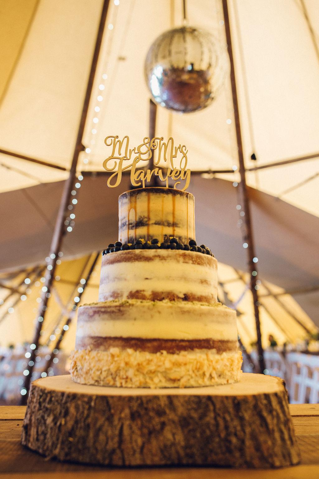 Boho Tipi Wedding with Alpacas wedding cake disco ball