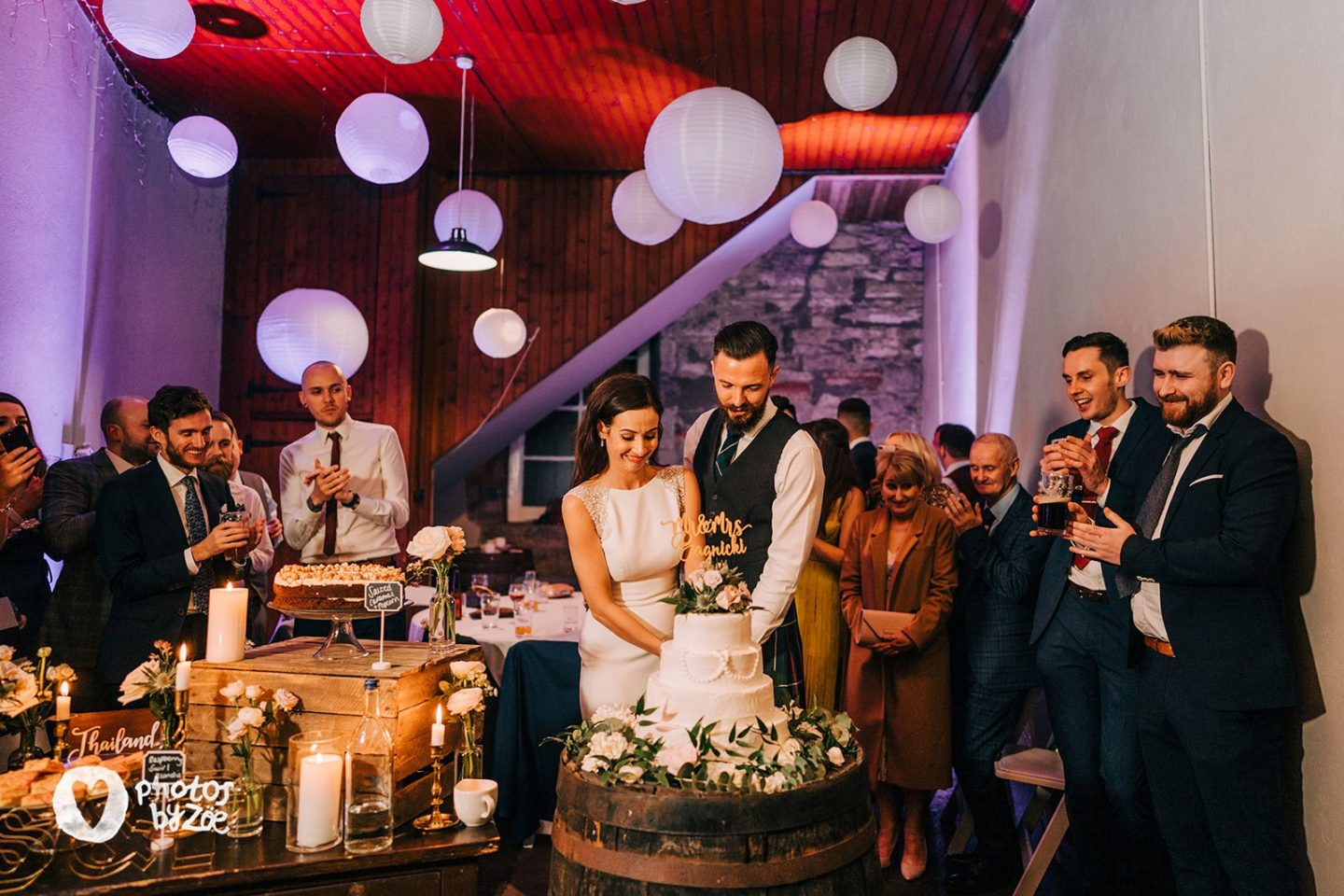 cutting of the cake, barn wedding, cosy country house wedding