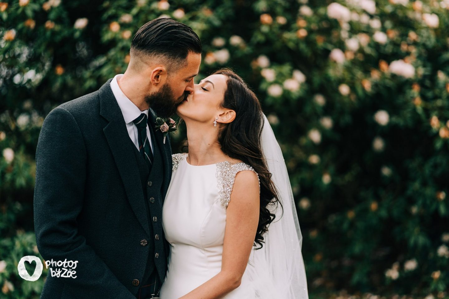 cosy country house wedding bride and groom first kiss