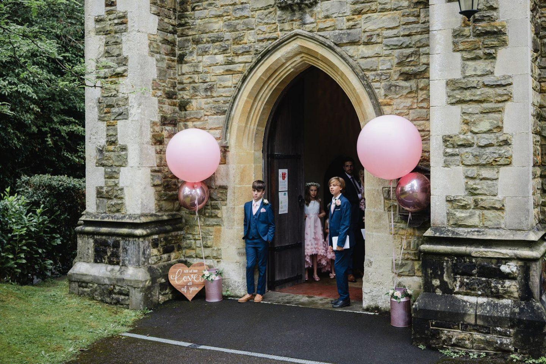 Bubblegum Balloons Wedding Decor, church entrance for ceremony
