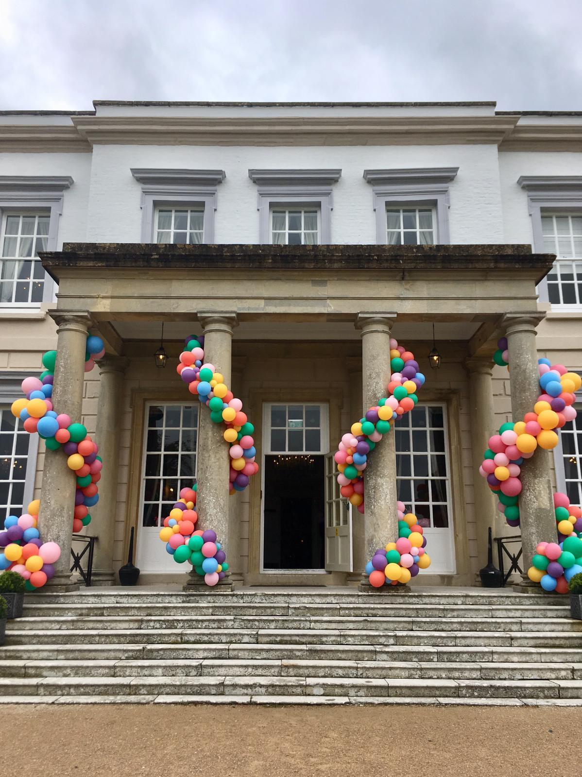 Bubblegum Balloons Wedding Decor, Buxted Park pillar decor wedding entrance