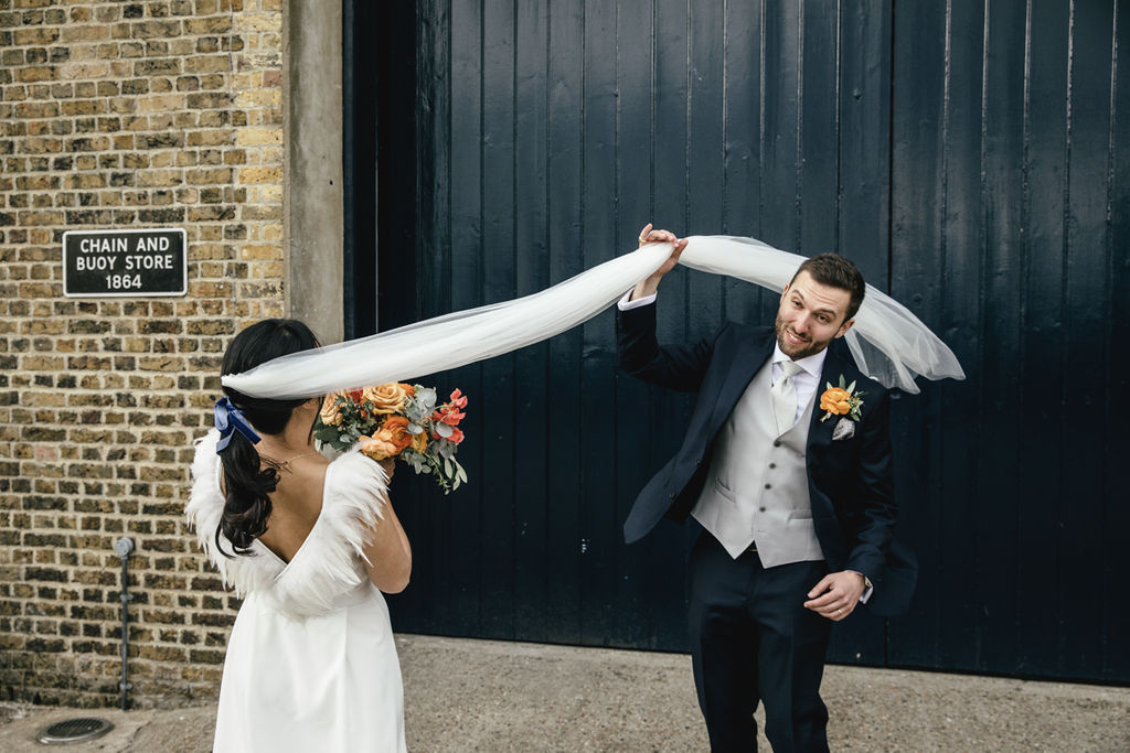 A contemporary and cool wedding at Trinity Buoy Wharf windy veil shot