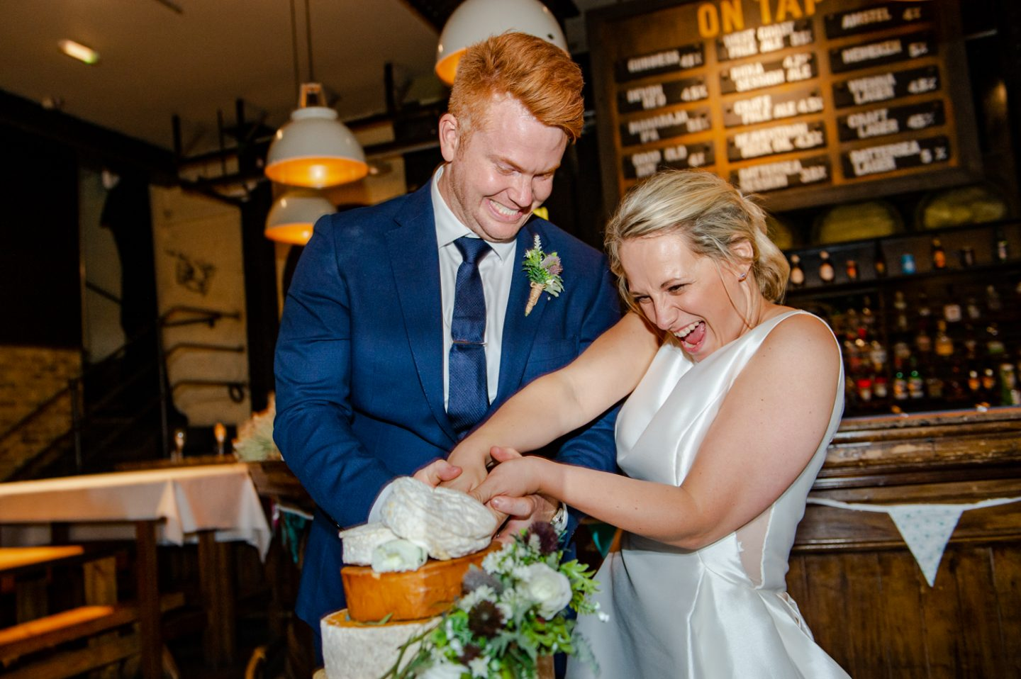 The Depot N7 London Pub Wedding cutting the cake cheese cake