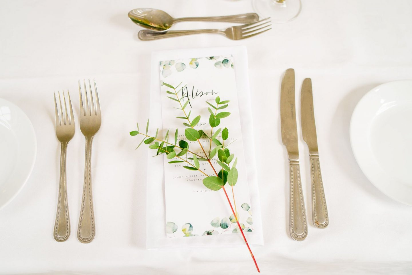 wedding at Clissold House greenery place setting eucalyptus