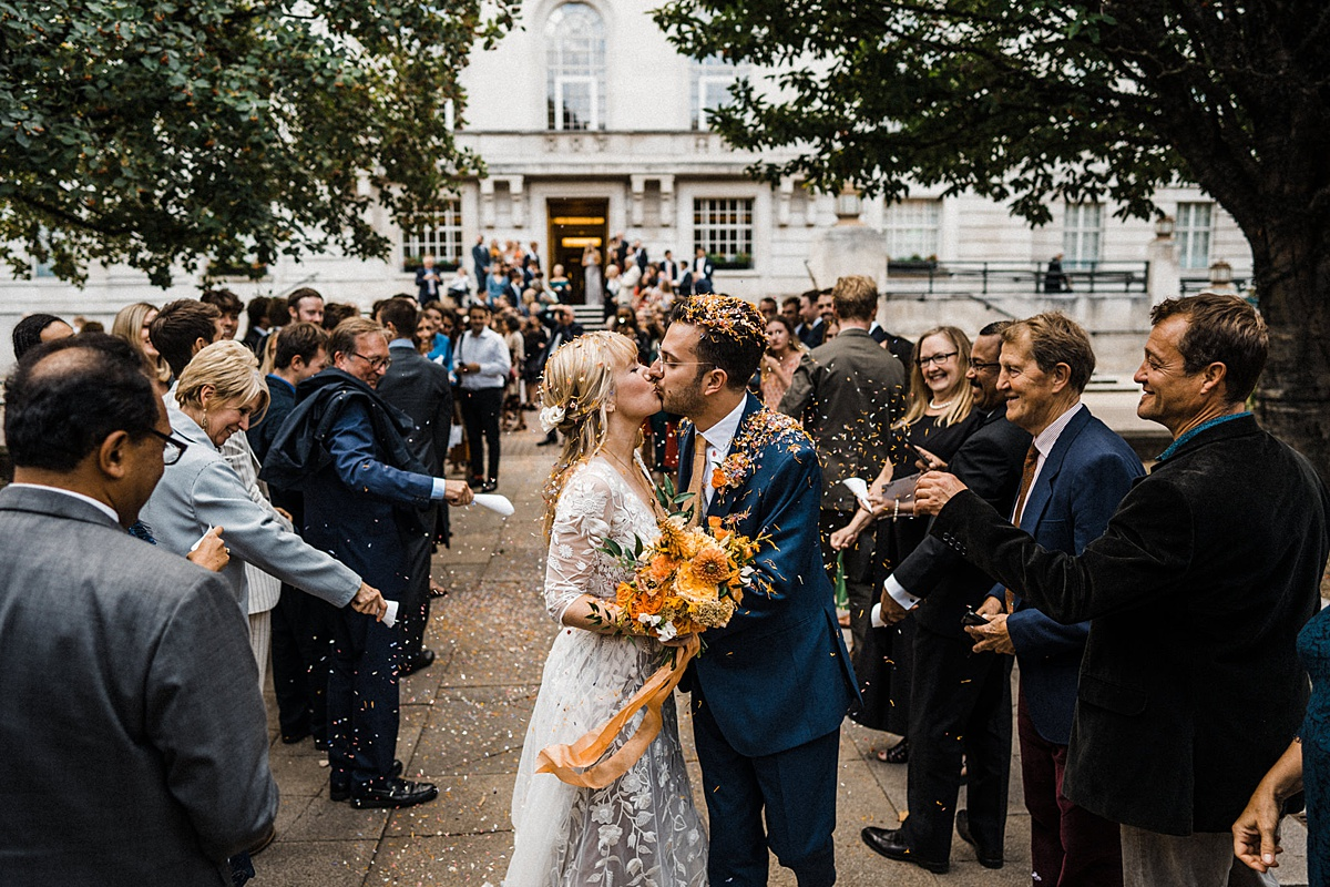 Hackney Town Hall Wedding The Atria confetti exit first kiss